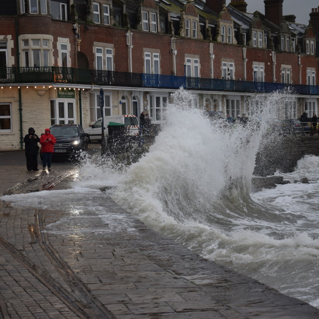 """Swannage battered by waves"" stock image"