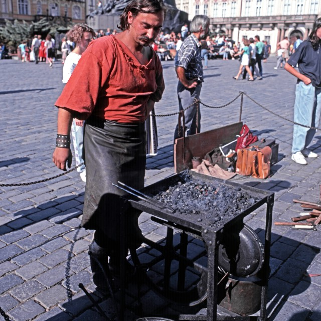 """""""Blacksmith working in the Old Square in Prague"""" stock image"""