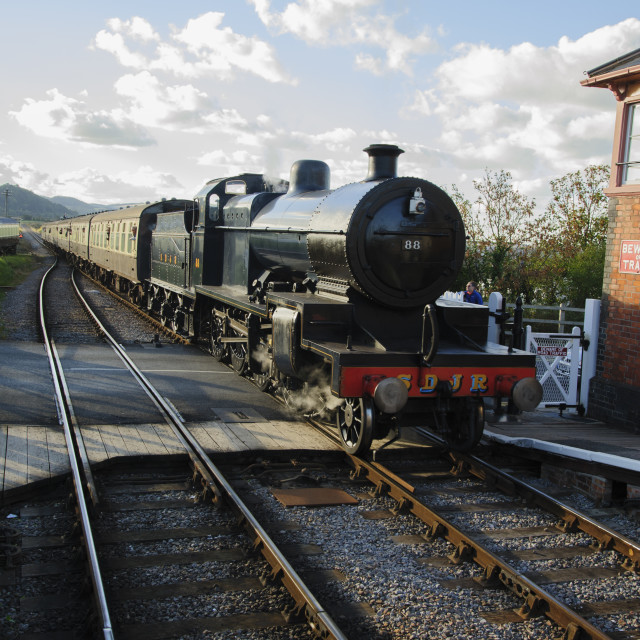 """Steam train arriving at Blue Anchor station."" stock image"