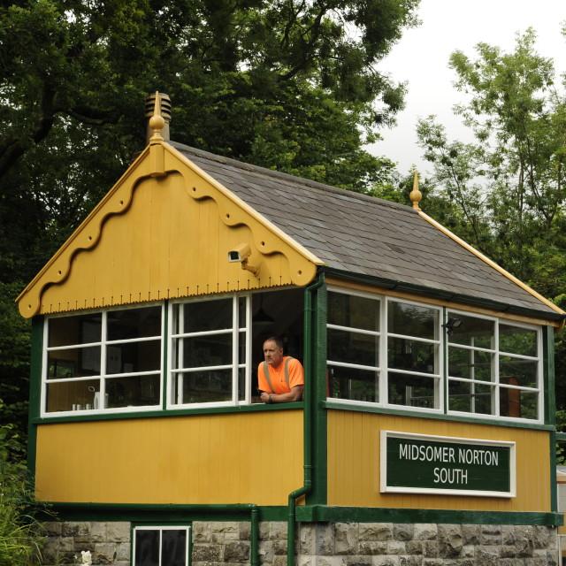 """Signalman at Midsomer Norton signalbox."" stock image"