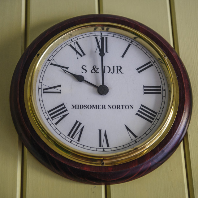 """""""Station clock on the Somerset and Dorset Railway"""" stock image"""