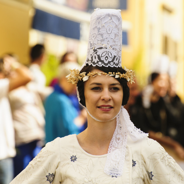 """Breton lady in traditional dress at fete folklorique"" stock image"