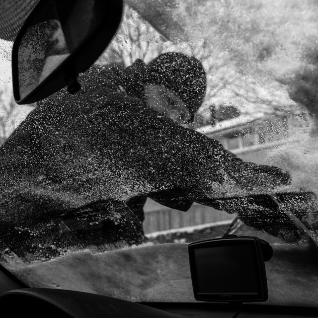 """Man Scraping Ice Off Car Window"" stock image"