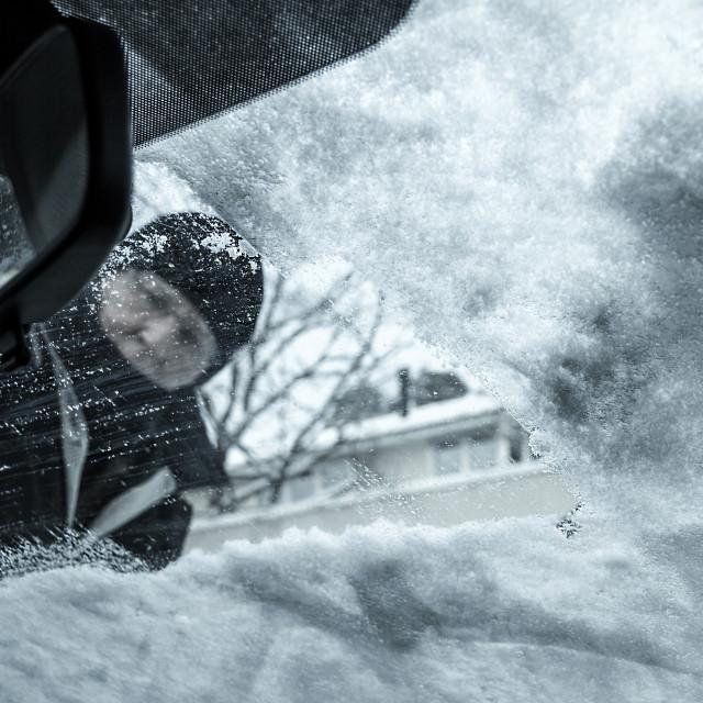 """Man Scraping Ice Off Car Window"" stock image"