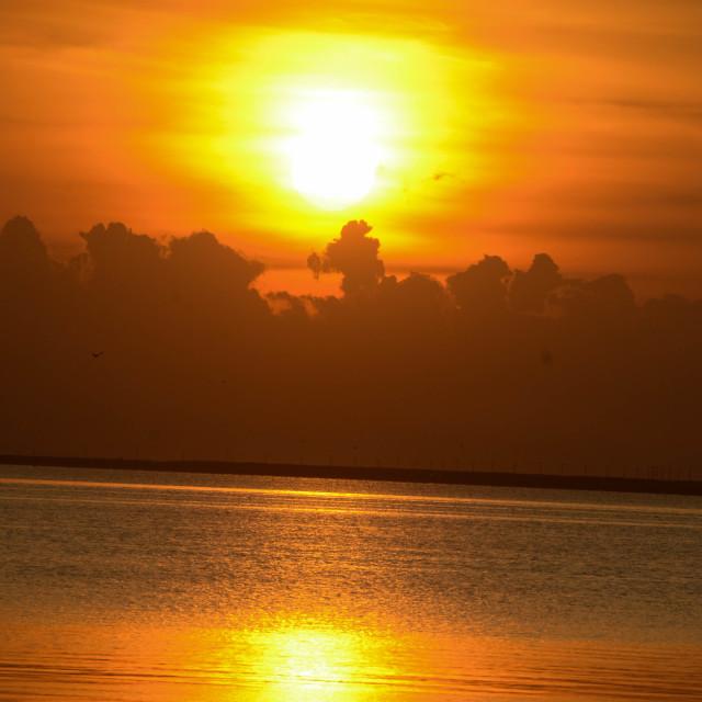 """Sunrise on the Waterfront"" stock image"