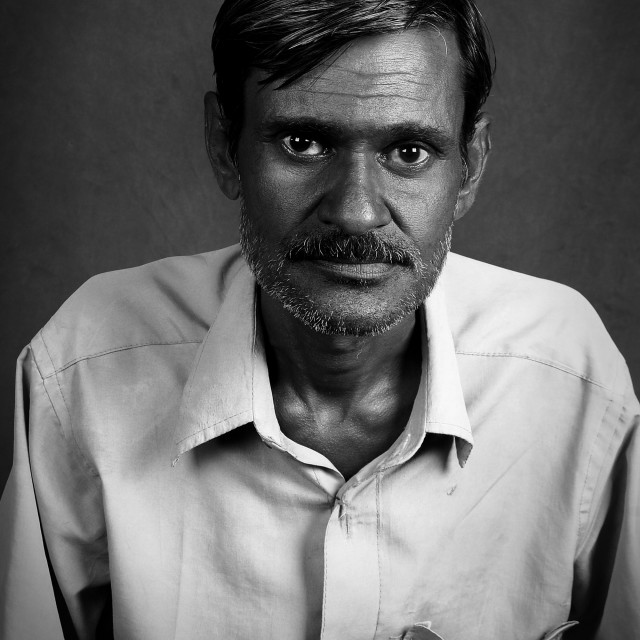 """Portrait of an Indian worker."" stock image"