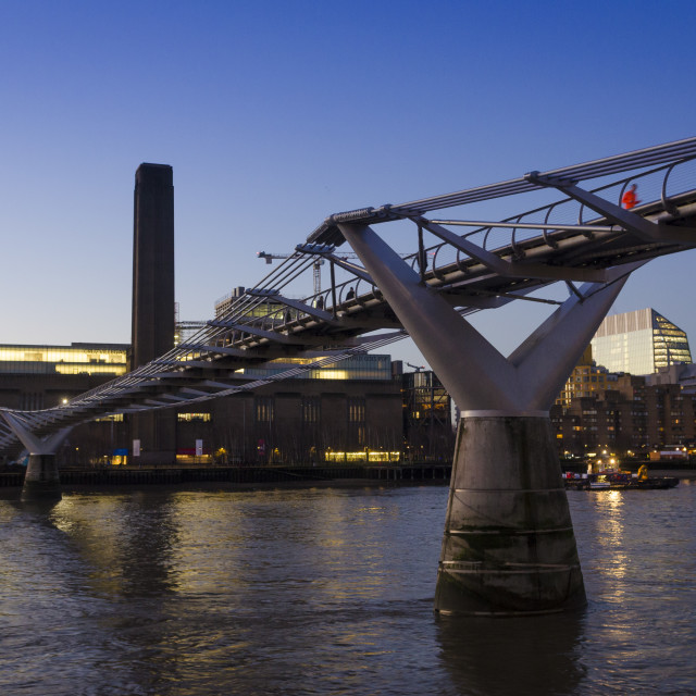 """Sunrise over the River Thames and The Tate Modern and Millennium Bridge"" stock image"
