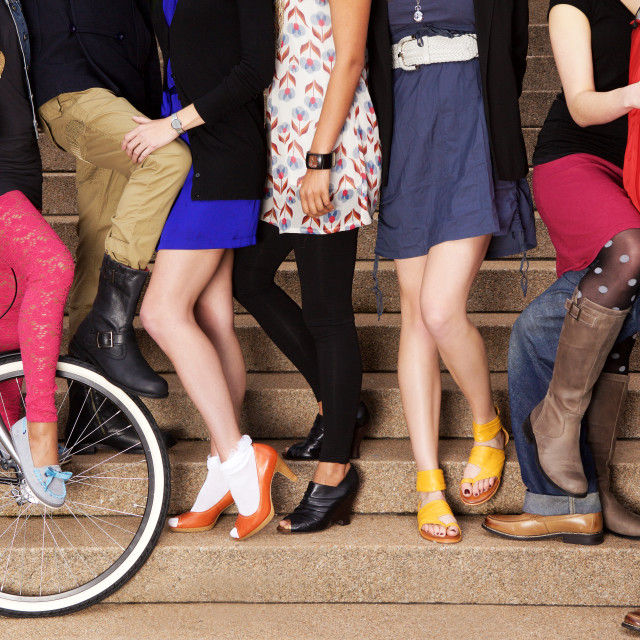 """Seven young dynamic fashionable people on stairs in the street."" stock image"