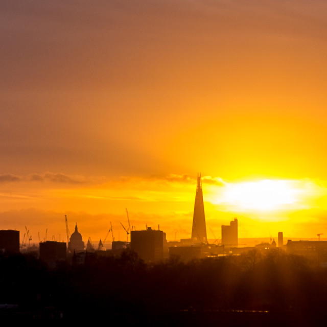 """The sun rises behind The Shard"" stock image"