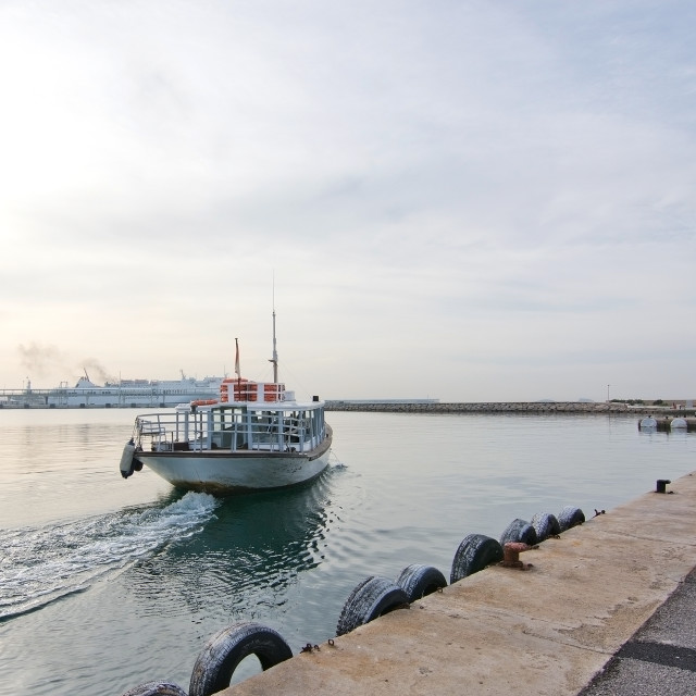 """Ferry boat leaving harbor"" stock image"