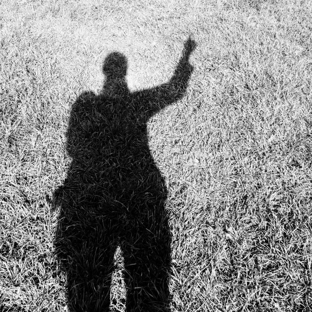 """""""Shadow of a woman pointing"""" stock image"""