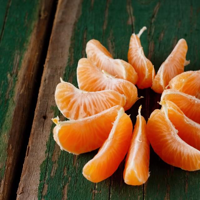 """Orange mandarin divided to pieces"" stock image"