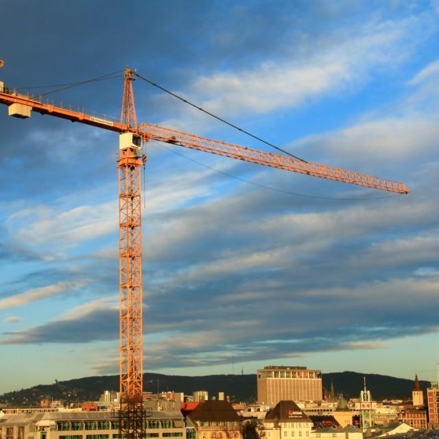 """Crane against blue sky"" stock image"