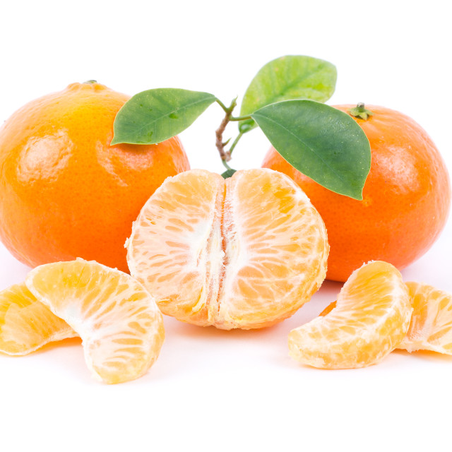 """Tangerines with leaves and slices"" stock image"