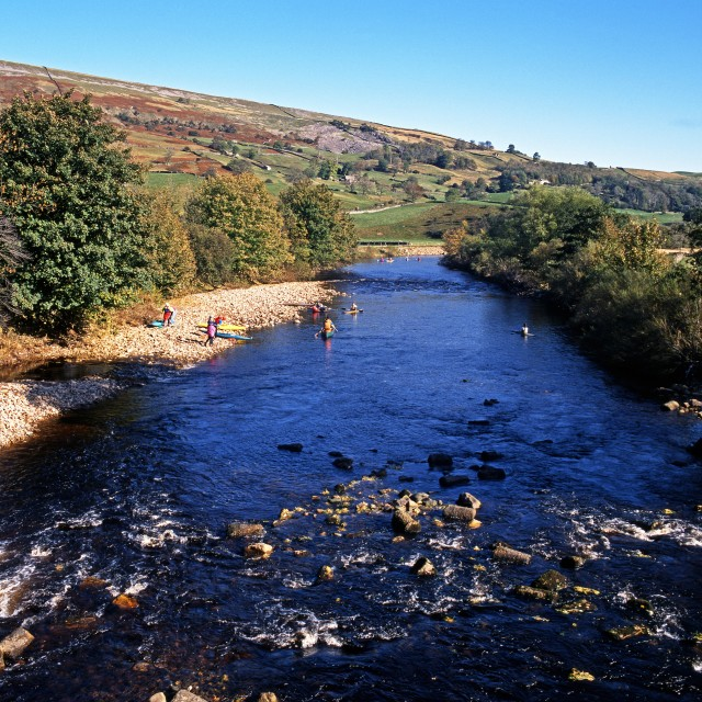 """""""Canoeists on the river Swale in the Yorkshire Dales, UK"""" stock image"""