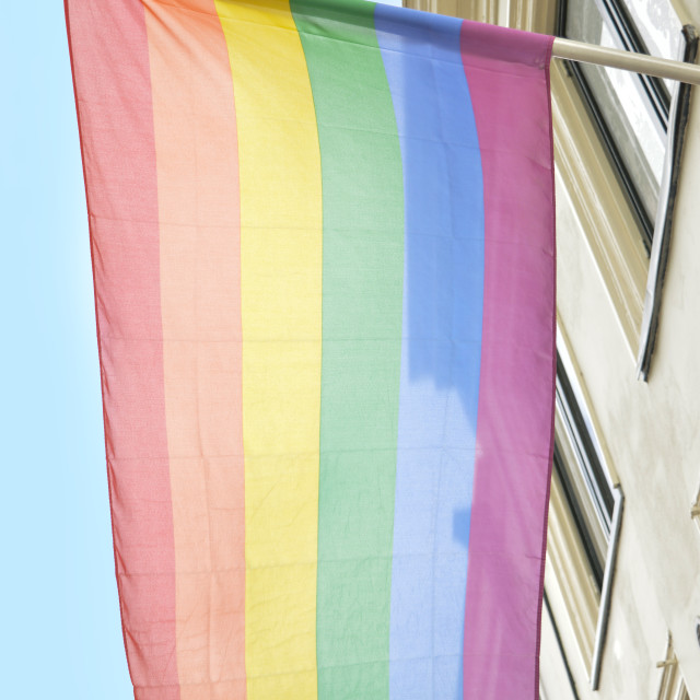 """""""rainbow flag hanging on a building"""" stock image"""