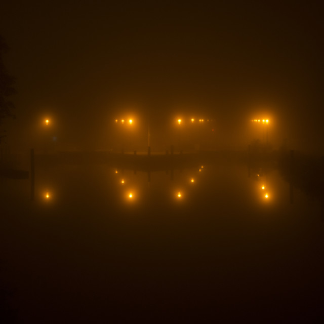 """Lights surrounding a lock in the mist"" stock image"