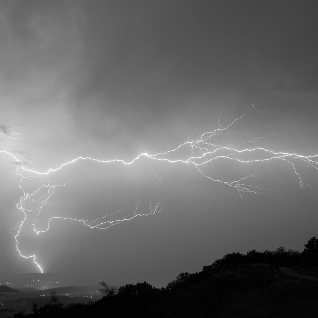 """Crawling and striking lightning bolts"" stock image"