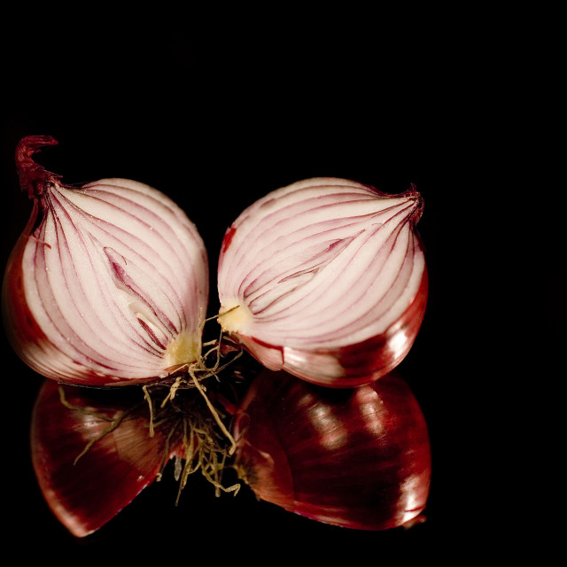 """""""two sliced onions on black"""" stock image"""