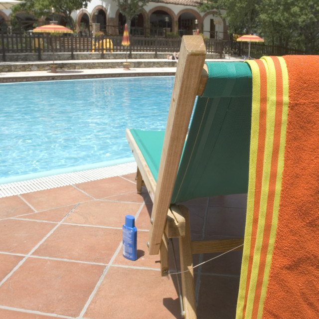 """Relaxing bed at swimmingpool"" stock image"