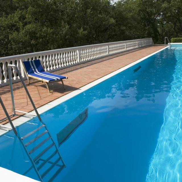 """blue bed near the swimmingpool"" stock image"