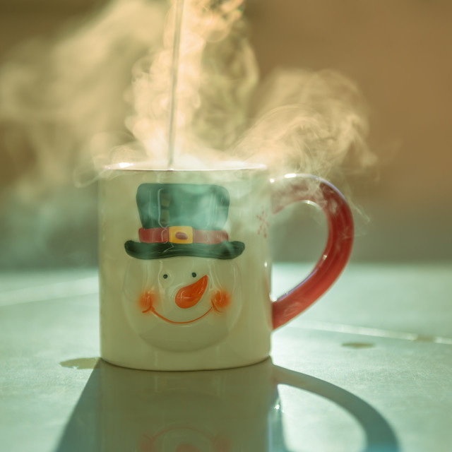 """Festive cup of hot tea"" stock image"