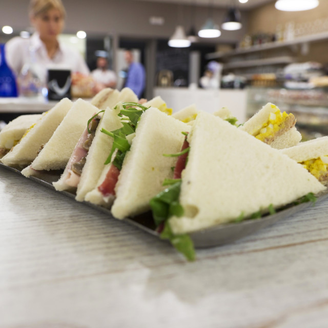 """""""Row of sandwiches in a bar"""" stock image"""