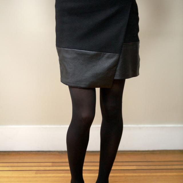 """""""Headless model wearing black skirt"""" stock image"""