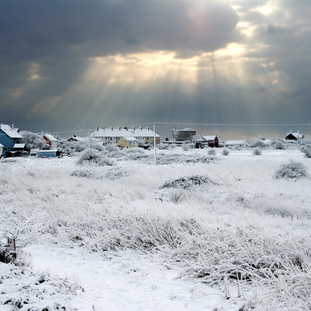 """Sunrays over frozen Felixstowe Ferry, Suffolk"" stock image"
