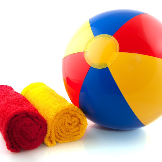 """Beachball and rolled towels"" stock image"