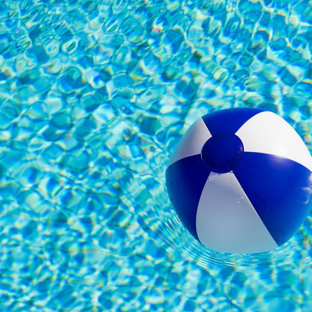 """Beach ball in swimming pool"" stock image"