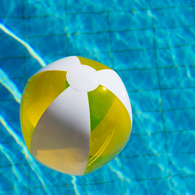 """Inflatable beach ball in water"" stock image"