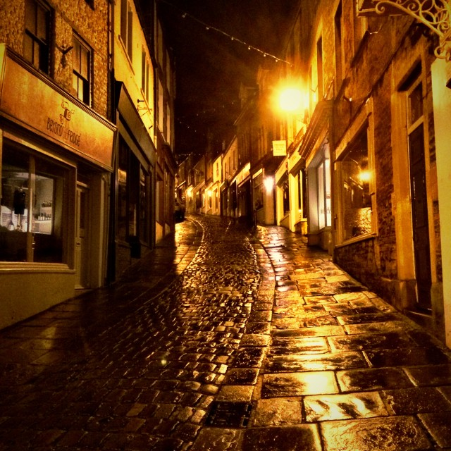 """Wet pavements and cobbled street, Catherine Hill, Frome, Somerset"" stock image"