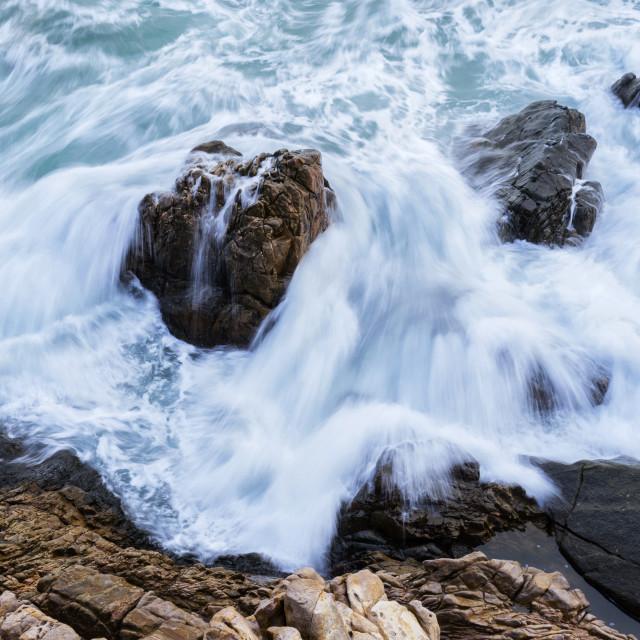 """Waves strike over rocks"" stock image"