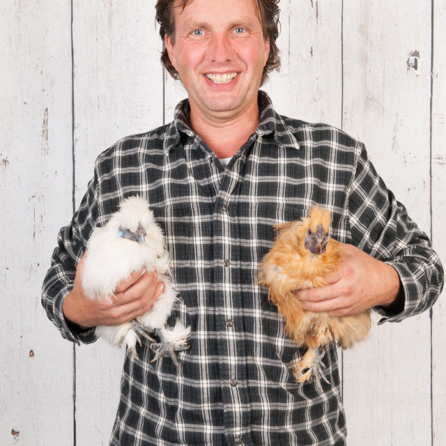 """""""Farmer with chickens"""" stock image"""
