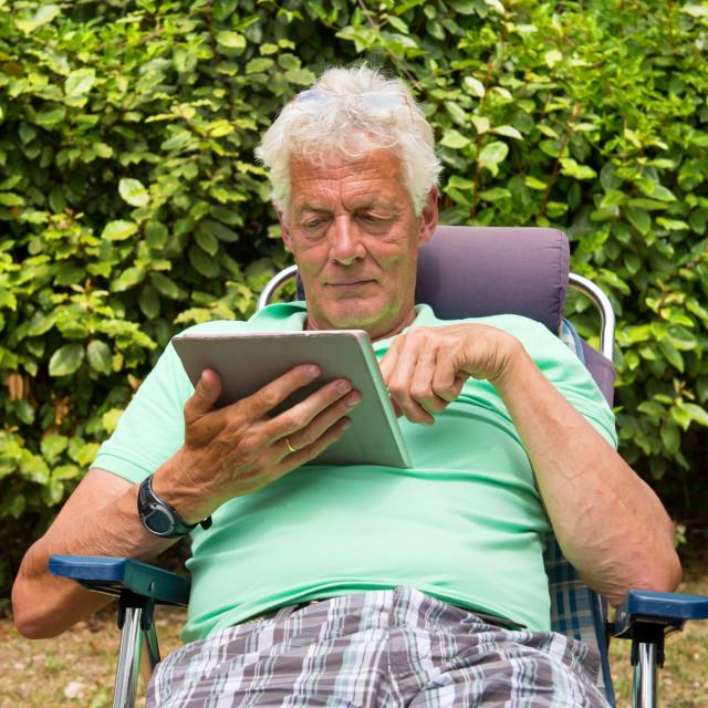 """Senior man with digital tablet"" stock image"