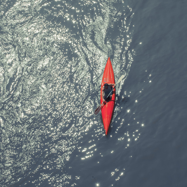 """Oarsman and canoe view from the top on a river"" stock image"