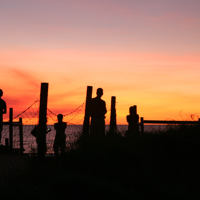 """Silhouettes at Sunset, Mindil Beach, Darwin"" stock image"