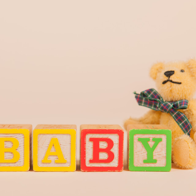 """""""Baby born with bear"""" stock image"""