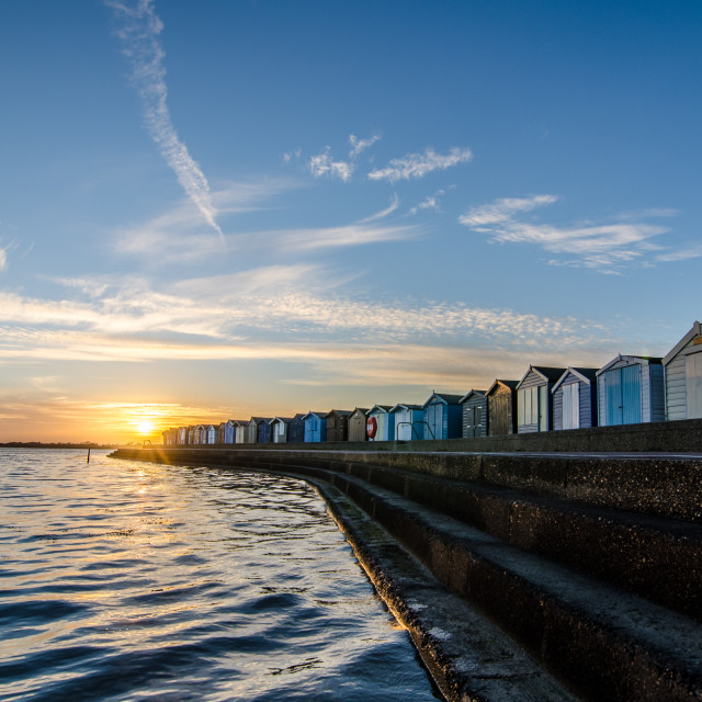 """Beach huts at sunset"" stock image"