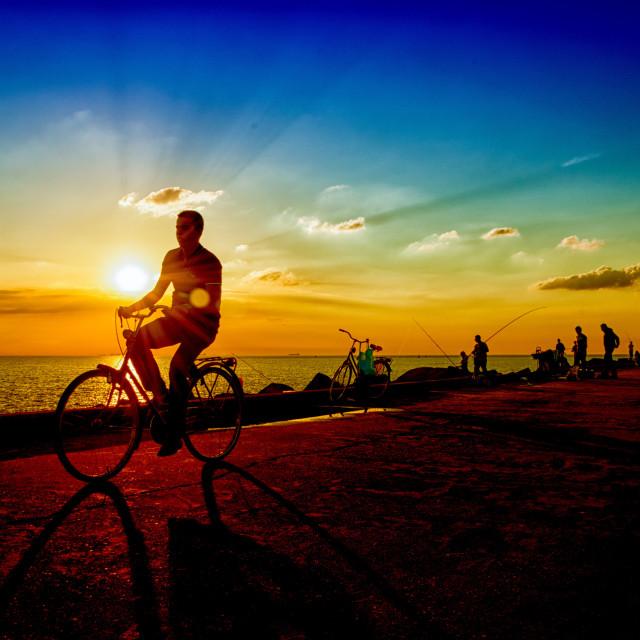 """""""Biking through Sunset"""" stock image"""