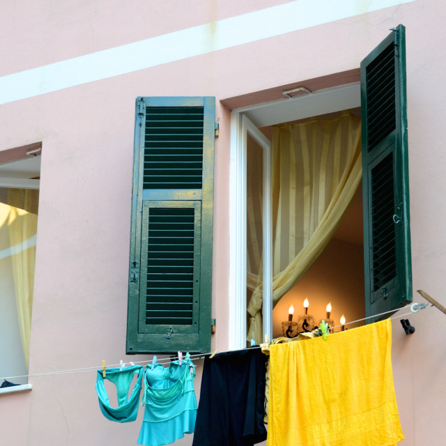 """Italian apartment hangs laundry to dry"" stock image"