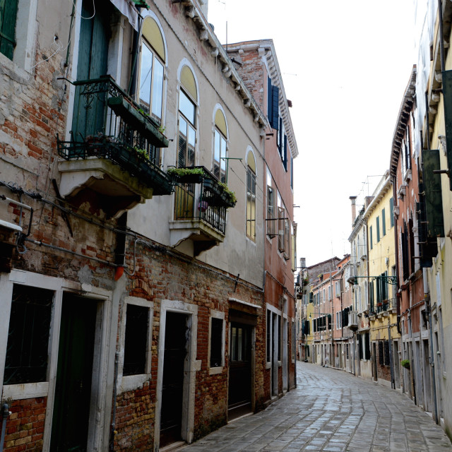 """Empty Venetian street curves away from camera"" stock image"