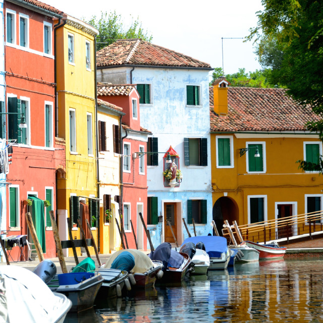 """Row of colorful boats and buildings in Burano Venice, Italy"" stock image"