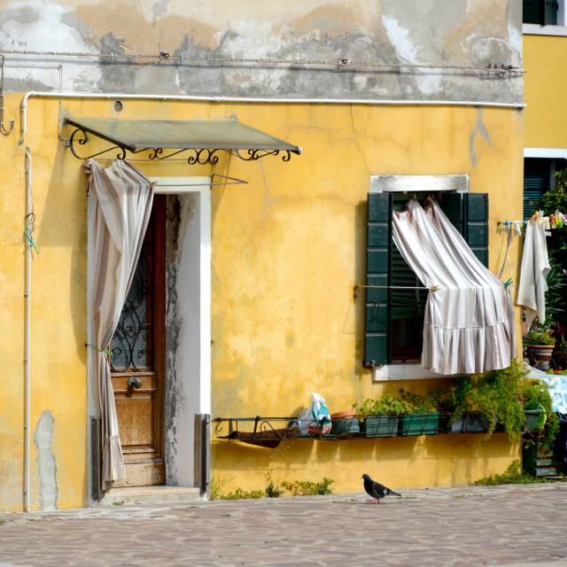 """Colorful yellow building corner in Burano, Italy"" stock image"