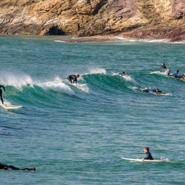 """""""Surfers on a wave at Polzeath"""" stock image"""