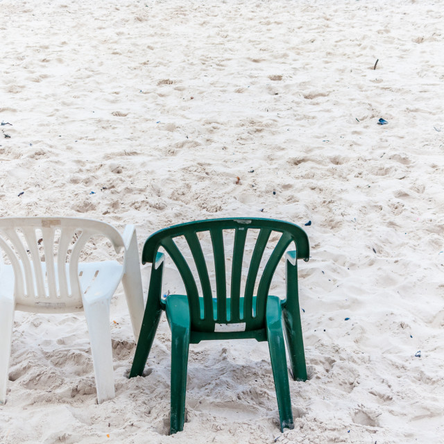 """""""Plastic chairs on a beach"""" stock image"""