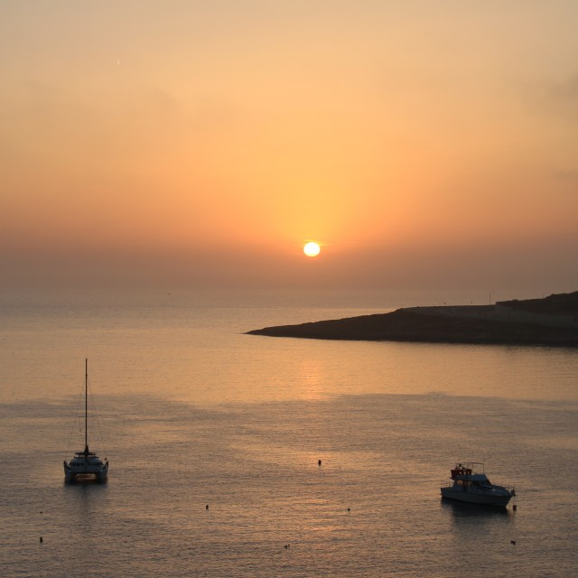 """sunrise in Qawra Malta"" stock image"