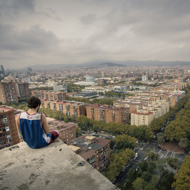 """Man on edge of abandoned skyscraper"" stock image"