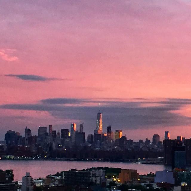 """Lower Manhattan under a purple sky"" stock image"